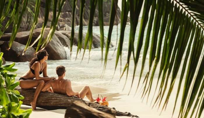 A couple having some quality time at a beautiful beach in Seychelles