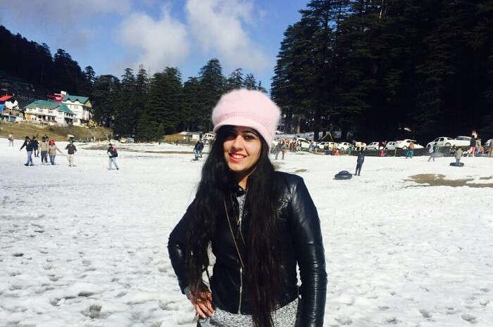 Girl posing amidst snow in Dalhousie