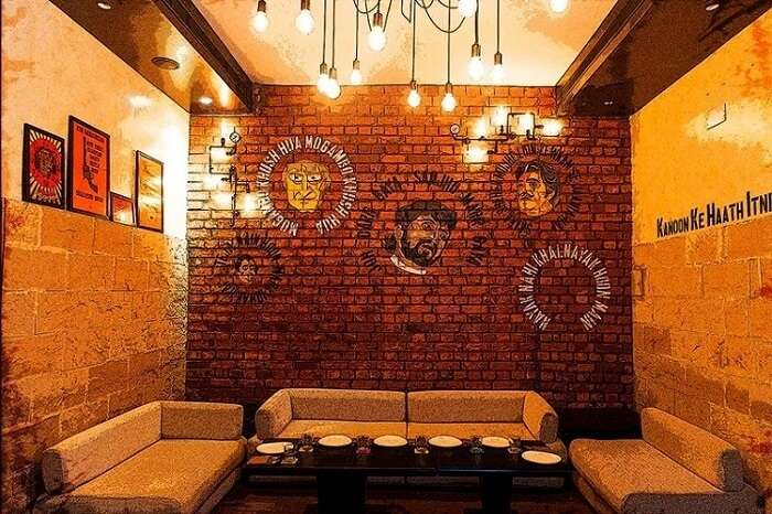 wall art and seating arrangement at Gabbar's Bar and Kitchen