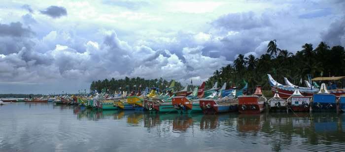 Several colorful boats stationed at Kozhikode Lake