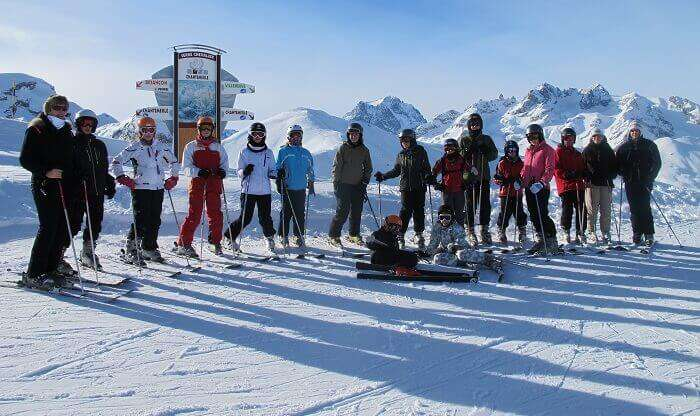 Young skiers wait for their ski trip to begin at the Serre Chevalier ski resort