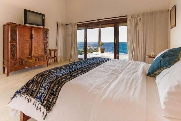 fully furnished bedroom with private pool in villa sarchi