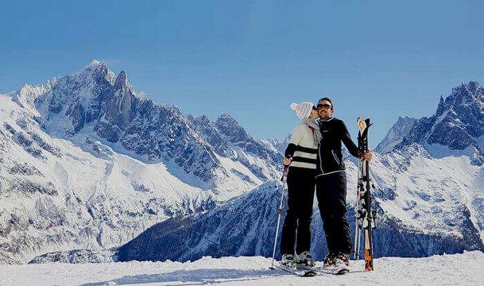 A couple enjoys their visit to the Chamonix ski resort