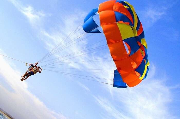 A couple tries parasailing in Goa