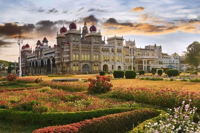 The famous Mysore Palace with the garden of flowers