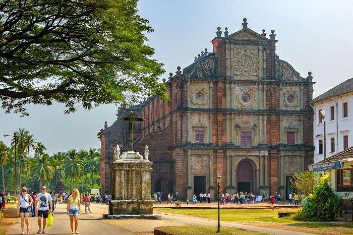 Unidentified tourists visit to the famous landmark - Basilica of Bom Jesus (Borea Jezuchi Bajilika) in Old Goa