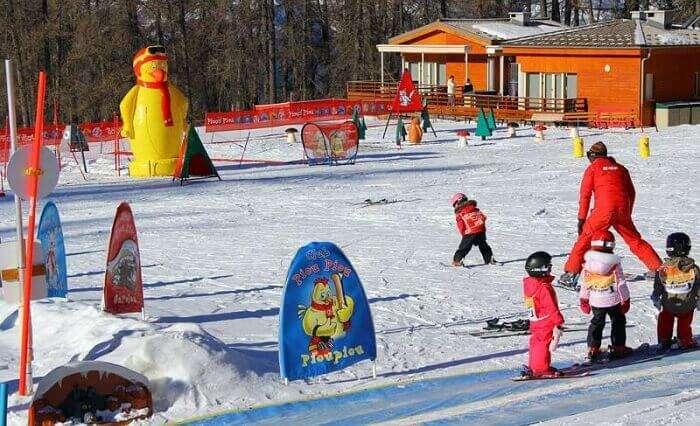 Kids learn how to ski at the Valberg ski resort