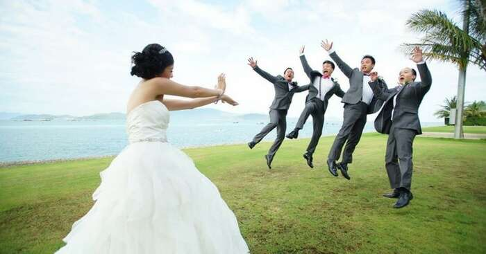 4 people posing for a shot at a bachelor party destination