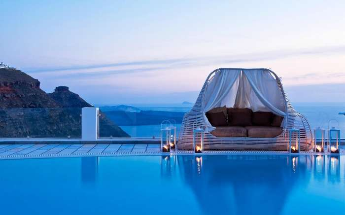 Dive between the two skies with your love at Santorini island Greece
