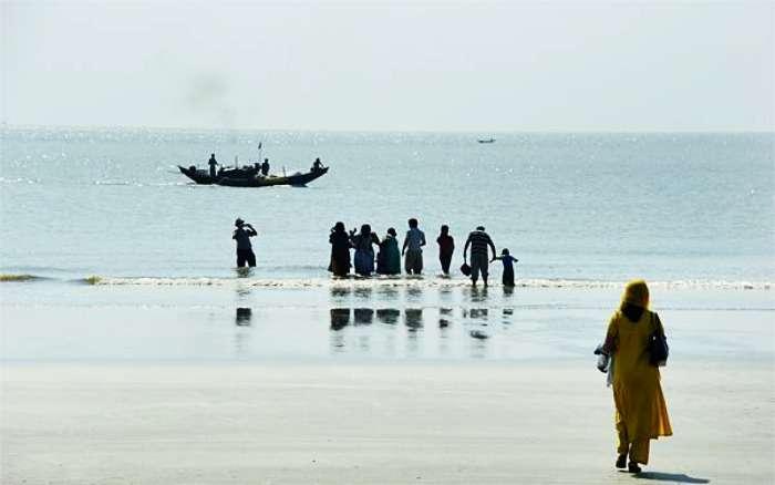 A family enjoy the sea waves at Bakkhali Beach