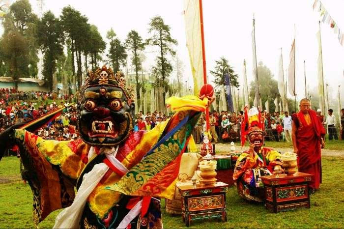 A lama performing the masked dance in Sikkim