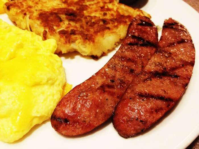 Scrumptious Alaska breakfast made up of pancakes, eggs and reindeer meat pieces.