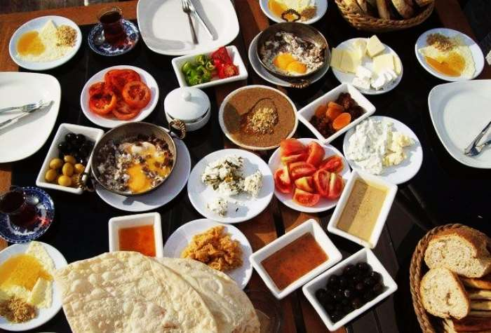 Jam, sausage, Turkish Tea, veggies and salads make for a healthy Turkish breakfast
