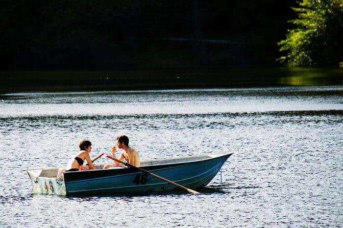 A couple rowing a boat