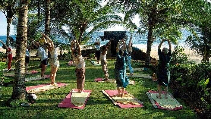 People practicing yoga at Sivananda Yoga Vedanta Dhanwantari Ashram in Kerala
