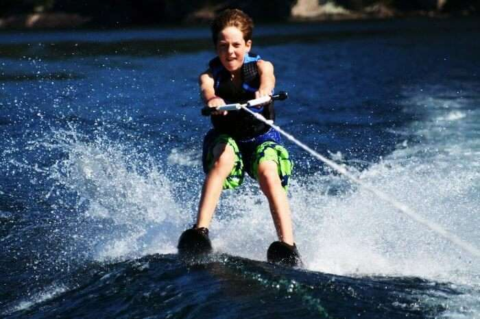 A kid water skiing in Thailand
