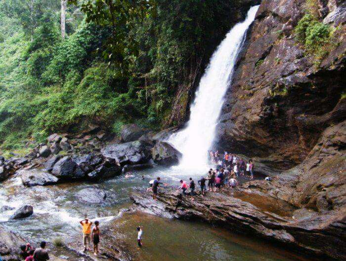 Tourists enjoying at the popular waterfalls of Chethalayam