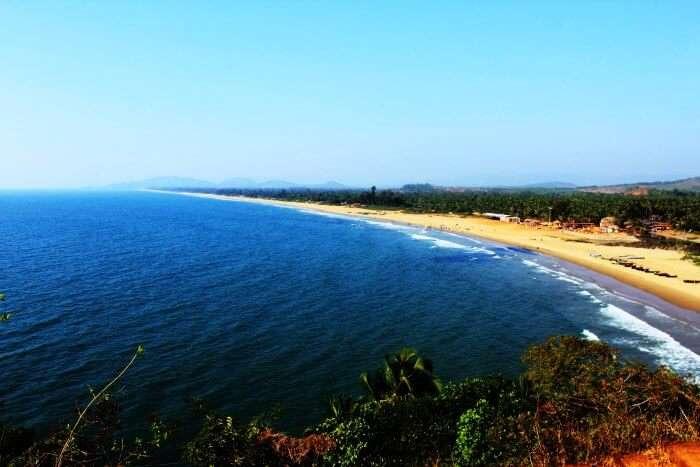 The crescent shaped Half Moon beach in Gokarna