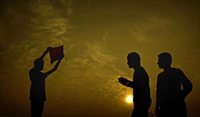 Young people flying kite in Ahmedabad