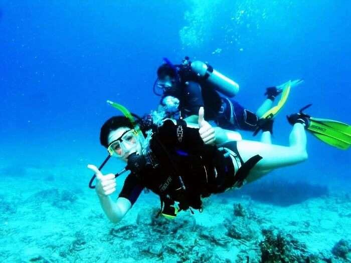 A woman scuba diving in Goa