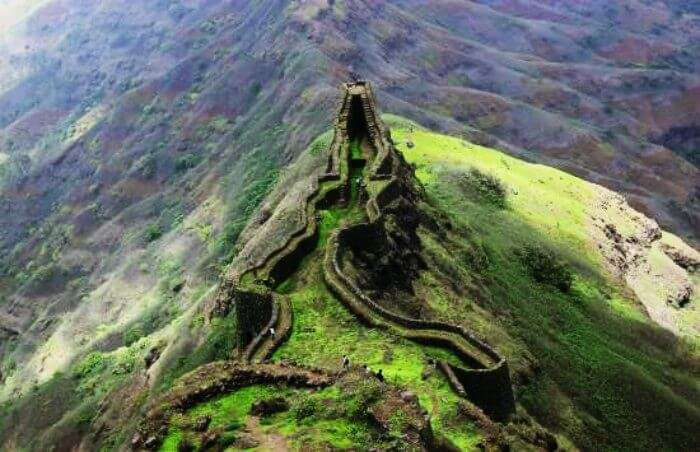 The top view of Torna Fort overlooking the valley during the rainy season