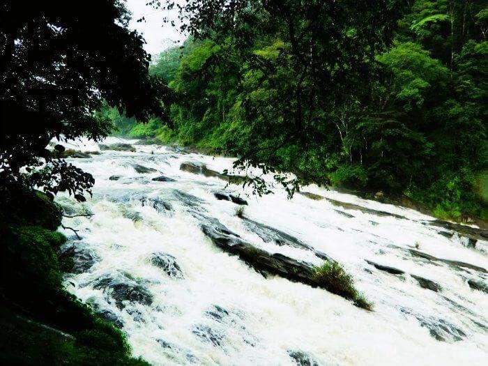 Water streaming down the beautiful falls of Vazhachaal in Kerala