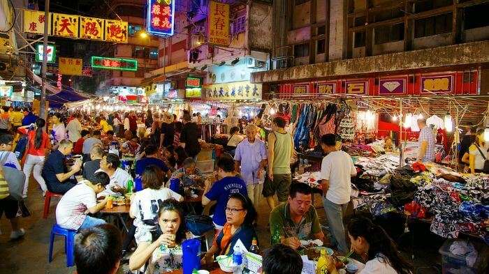 Tourists exploring the nightlife in Bali with a crazy shopping experience in Kuta Market