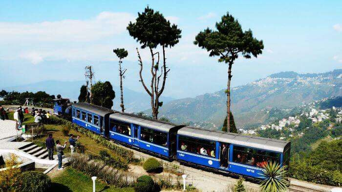 Tourists clicking pictures of the toy train from New Jalpaiguri to Darjeeling