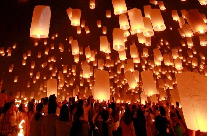 People lighting candles at Full moon party in Thailand