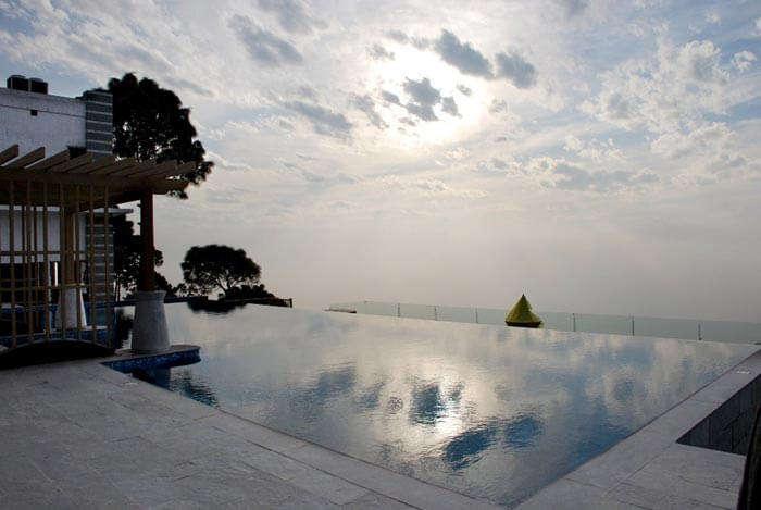 Breathtaking view from the pool at Moksha Himalaya Spa Resort - a fine luxury resort near Chandigarh