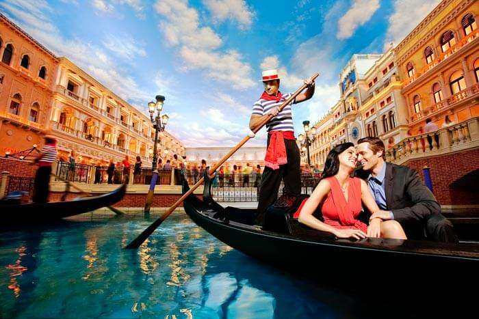 A couple on a boat in Venice