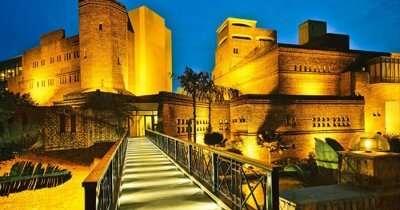 The beautifully lit Ffort Resort at night