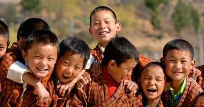 Happy kids smiling in the valleys of Bhutan