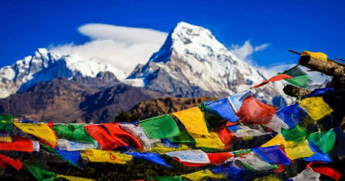 A view of the the prayer flags of Nepal and Himalayas beyond