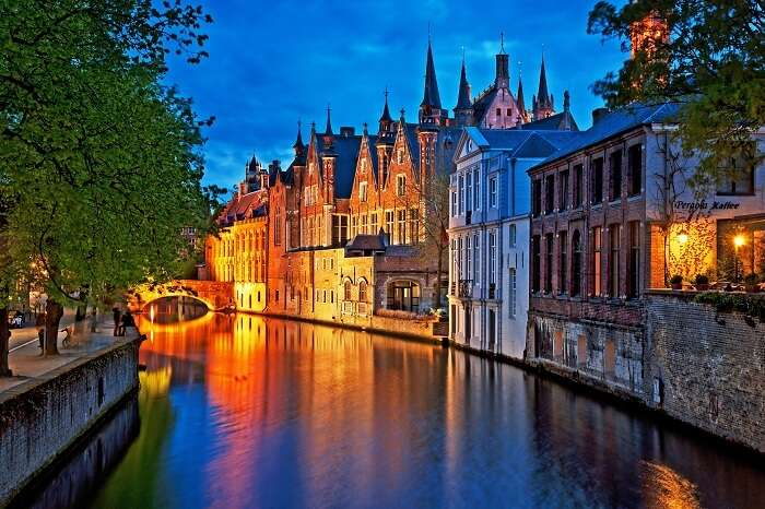 Night shot of historic medieval buildings along a canal in the city of Bruges in Belgium