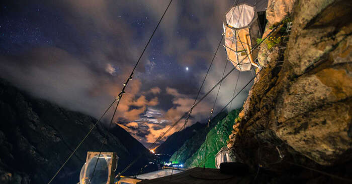 A night shot of skylodging in Peru