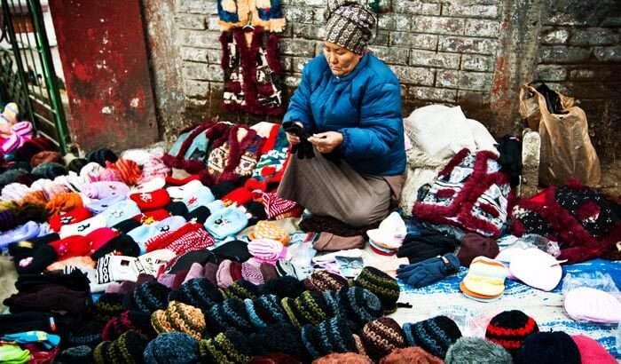 A woman selling woollens at Bhutia Market, Darjeeling