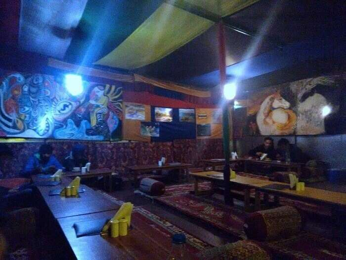 The dark interiors of a cafe in Kasol