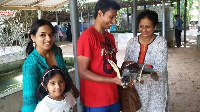 Roshan with his family in the turtle hatchery