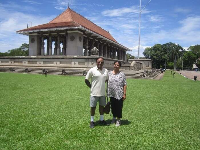 Roshans parents posing in a garden in Colombo