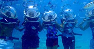 The family enjoying the underwater sea walk