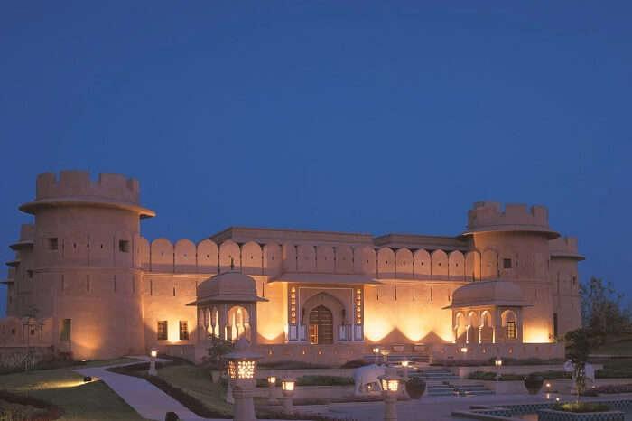 A shot of the beautifully lit Oberoi Rajvilas Resort in Jaipur