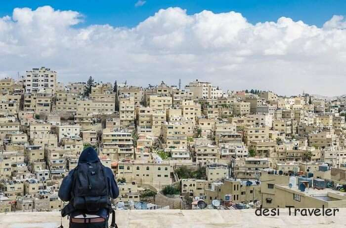 A person in the background of Amman skyline in Jordan