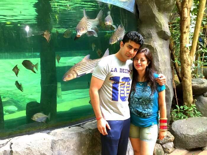 In front of an aquarium at the Under Water World Langkawi
