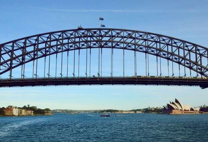 The beautiful waters flowing beneath the gigantic Sydney Harbour Bridge