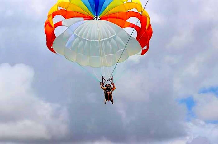 Tarun and his wife on a parachute