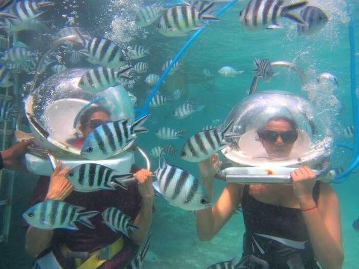 Chiranths wife enjoying the mesmerizing view of the underwater sea walk