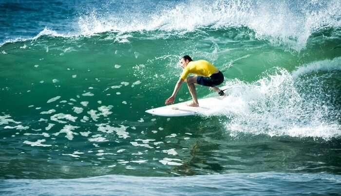 A surfer taking on the waves at Talalla in Sri Lanka
