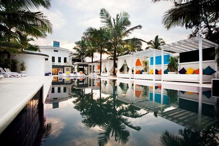 The serene pool and colorful patio of the Park Calangute in Goa