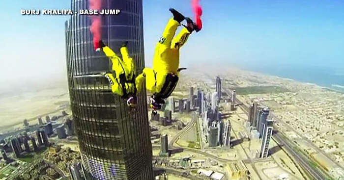 Skydivers base jumping from Burj Khalifa